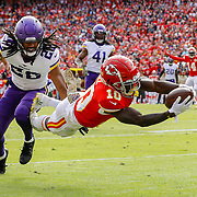 KANSAS CITY, MO - NOVEMBER 03: Tyreek Hill #10 of the Kansas City Chiefs leaps to the goal line on a 40-yard touchdown pass behind the defense of Trae Waynes #26 of the Minnesota Vikings in the first quarter at Arrowhead Stadium on November 3, 2019 in Kansas City, Missouri. (Photo by David Eulitt/Getty Images)