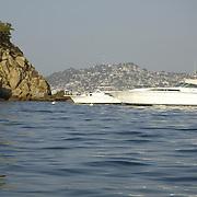 Tourist yachts near island. Acapuco, Guerrero. Mexico.