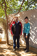 """CLIENT: THE WASHINGTON POST<br /> <br /> Laura Amayrani Ayon Robles, 20, with her father-in-law Jose Antonio Pena Grey, 64, at a family home in the town of Cosala, in the Mexican state of Sinaloa. Laura was home alone when Marine helicopters began circling the family ranch in the Sierra Madre mountains on the morning of October 6, 2015.  When she went outside to investigate, they opened fire, bullets landing within arms reach of her.  She and four family members, including Jose, walked through the woods for four days to reach safety. The ranch is a few miles from where, the day before, the military attempted and failed to capture Joaquin """"El Chapo"""" Guzman, the head of the Sinaloa cartel."""