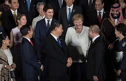 Wife of Joko Widodo and Indonesia's President Joko Widodo, Canada's Prime Minister Justin Trudeau's wife Sophie Gregoire, Justin Trudeau', President Xi Jinping, German Chancelor Angela Merkel and Russia President Vladimir Putin and Saudi Arabia's Crown Prince Mohammed bin Salman during family photo session on the first day of the G20 summit in Osaka, Japan on June 28, 2019. Photo by Jacques Witt/Pool/ABACAPRESS.COM