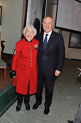 IAIN DUNCAN SMITH and Chelsea Pensioner DOROTHY HUGHES at a reception to view and buy cushions, quilts, bags and gifts Hand-stitched in British prisons held at The Riffles Club, 56 Davies Street, London W1 on 26th April 2012.