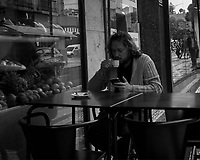 Europeans drink coffee from small cups. Afternoon walkabout in Lisbon. Image taken with a Leica CL camera and 23 mm f/2 lens.