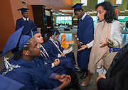 Students prepare during the first ever graduation for Mickey Leland College Preparatory Academy, May 27, 2015.