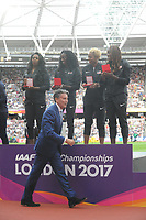 Athletics - 2017 IAAF London World Athletics Championships - Day One<br /> <br /> Coe Coe - President of the International Association of Athletics Federations at the Medal Ceremonies for re homing of medals from positive drug testing gives the USA team their Gold medials in the 4 x 400 Womens relay at the London Stadiuim.<br /> <br /> COLORSPORT/ANDREW COWIE