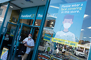 With most shops now open but with retail sales suffering due to the Coronavirus pandemic, shoppers wearing face maks, which became compulsory in shops on the 24th July, go out shopping to Poundland on Kings Heath High Street on 31st July 2020 in Birmingham, United Kingdom. Coronavirus or Covid-19 is a respiratory illness that has not previously been seen in humans. While much or Europe has been placed into lockdown, the UK government has put in place more stringent rules as part of their long term strategy, and in particular social distancing.