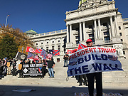 """Harrisburg, PA (November 5, 2016) -- Arthur J. Jones, Jr., a Donald Trump supporter, holds a banner reading """"President Trump Build The Wall"""" at a rally of the white supremacist National Socialist Movement on the steps of the Pennsylvania State Capitol."""