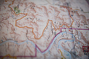 SHOT 10/14/16 12:24:46 PM - A map detailing the White Rim trail. It is a mountain biking trip in Canyonlands National Park just outside of Moab, Utah. The White Rim Road is a 71.2-mile-long unpaved four-wheel drive road that traverses the top of the White Rim Sandstone formation below the Island in the Sky mesa of Canyonlands National Park in southern Utah in the United States. The road was constructed in the 1950s by the Atomic Energy Commission to provide access for individual prospectors intent on mining uranium deposits for use in nuclear weapons production during the Cold War. Four-wheel drive vehicles and mountain bikes are the most common modes of transport though horseback riding and hiking are also permitted.<br /> (Photo by Marc Piscotty / © 2016)