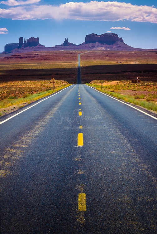 """Monument Valley (Navajo: Tsé Bii' Ndzisgaii, meaning valley of the rocks) is a region of the Colorado Plateau characterized by a cluster of vast sandstone buttes, the largest reaching 1,000 ft above the valley floor. It is located on the Arizona-Utah state line, near the Four Corners area. The valley lies within the range of the Navajo Nation Reservation and is accessible from U.S. Highway 163. Monument Valley has been featured in many forms of media since the 1930s. Director John Ford used the location for a number of his best-known films, and thus, in the words of critic Keith Phipps, """"its five square miles have defined what decades of moviegoers think of when they imagine the American West."""""""