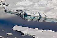 Abstract reflections in calm water at the edge of pack ice near Peter 1 Øy, Phantom Coast, Antarctica
