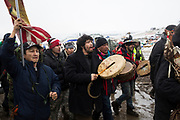 Protesters leaving the Oceti Camp at Standing Rock participate in a prayer walk leading many of the protesters out of the camp before their two p.m. deadline to vacate the camp.