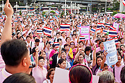 """Apr. 2, 2010 - BANGKOK, THAILAND: Thousands of """"Pink Shirts,"""" who claim to be neither """"Red Shirts"""" nor """"Yellow Shirts"""" nicknames for Thailand's dueling political forces, gathered in Lumpini Park in central Bangkok Friday evening to call for """"peace in the land,"""" a play on the Red Shirts slogan, """"Red in the Land."""" The """"Pink Shirts"""" represented educators, business people and people in the tourist industry, all of which have been hurt by the ongoing political protests that have disrupted life in the Thai capital. The """"Pink Shirts"""" stressed their loyalty to His Majesty Bhumibol Adulyadej, the King of Thailand, and chanted for the Red Shirts to """"Get Out!"""" of Bangkok.    PHOTO BY JACK KURTZ"""