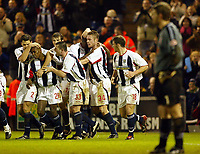 Photograph: Scott Heavey.<br /> West Bromwich Albion v Walsall. Nationwide Division One. 09/01/2004.<br /> Geoff Horsfield is mobbed by his team-mates after scoring Albions second