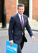 © Licensed to London News Pictures. 26/07/2012. Westminster, UK David Beckham in Downing Street England today 26 July 2012. Beckham is the Goodwill Ambassador for UNICEF, a global leader on child nutrition, he visited the Prime Minister in Downing Street to personally deliver a letter to Cameron that has been co-signed by over 50 of the highest profile sporting and entertainment stars from around the world. The impressive list calling for action on child malnutrition across the world. Photo credit : Stephen Simpson/LNP