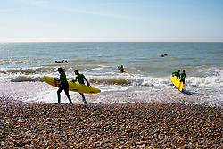 © Licensed to London News Pictures. 29/03/2014. Brighton, UK. People practice surf rescue.  People enjoy the sunny weather in Brighton today 29th March 2014. The warm weather is forecast to remain into next week. Photo credit : Stephen Simpson/LNP