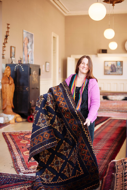 Portrait of young woman working in rug store in Eureka, CA.