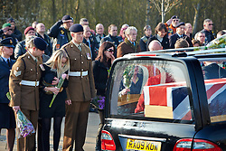 © Licensed to London News Pictures.  13/03/2014. CARTERTON, UK. Friends and family pay their respects during the repatriation ceremony of Sapper Adam Moralee, from 32 Engineer Regiment. He was killed in an accident while preparing equipment at Camp Bastion in Afghanistan. Photo credit: Cliff Hide/LNP