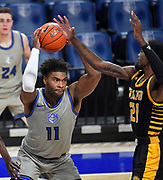 St Louis Billikens forward Hasahn French (11, left) pulls down a rebound as Arkansas-Pine Bluff Golden Lions guard Shaun Doss Jr. (21) also grabs for it. St. Louis University hosted the University of Arkansas - Pine Bluff in a mens basketball game on December 5, 2020 at Chaifetz Arena on the SLU campus in St. Louis, MO.<br />Photo by Tim Vizer