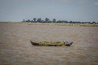 Locals ply the massive Irrawaddy river on small boats around Mandalay, Burma.