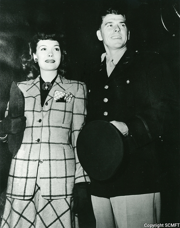 1943 Ronald Reagan & Jane Wyman arrive at the Hollywood Canteen for the Canteen's first anniversary