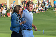 Corey Conners (CAN) and his wife Malory depart the green on 18 to sign his scorecard after winning the Valero Texas Open, at the TPC San Antonio Oaks Course, San Antonio, Texas, USA. 4/7/2019.<br /> Picture: Golffile | Ken Murray<br /> <br /> <br /> All photo usage must carry mandatory copyright credit (© Golffile | Ken Murray)