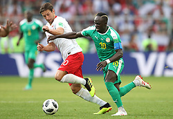 Poland's Grzegorz Krychowiak (left) and Senegal's Sadio Mane battle for the ball