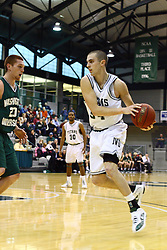 17 December 2011: John Koschnitzky passes around Dylan Richter  during an NCAA mens division 3 basketball game between the Washington University Bears and the Illinois Wesleyan Titans in Shirk Center, Bloomington IL