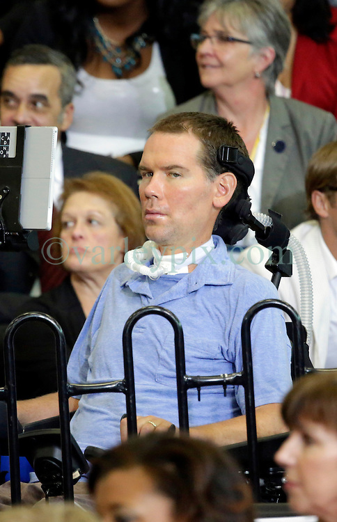 27 August 2015. Andrew P. Sanchez & Copelin-Byrd Multi Service Center, Lower 9th Ward, New Orleans, Louisiana.<br /> Steve Gleason, former pro football player with the NFL's New Orleans Saints awaits remarks  from President Obama. Gleason who suffers from ALS is founder of the Gleason Initiative Foundation.<br /> Photo credit©; Charlie Varley/varleypix.com.