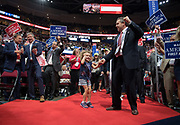 GOP delegates dance in the aisles during the Republican National Convention July 20, 2016 in Cleveland, Ohio.