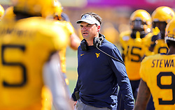 Sep 14, 2019; Morgantown, WV, USA; West Virginia Mountaineers head coach Neal Brown along the sidelines during the third quarter against the North Carolina State Wolfpack at Mountaineer Field at Milan Puskar Stadium. Mandatory Credit: Ben Queen-USA TODAY Sports