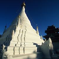 Wat Phra That Doi Kong Mu temple under blue skies in evening light, Mae Hong Son, Thailand