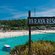 The wooden sign of the Raya Bungalow Resort from its viewpoint