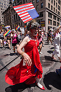 """New York, NY - 25 June 2017. New York City Heritage of Pride March filled Fifth Avenue for hours with groups from the LGBT community and it's supporters. Marchers with a sign on an upside-down American flag with a quote from Theodore Roosevelt: """"Patriotism means to stand by the nation, not the President."""""""