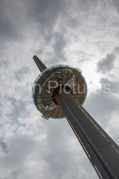The British Airways i360 ride on the Brighton and Hove seafront on the 19th July 2018 in Brighton in the United Kingdom. The British Airways i360 is a 162-metre observation tower on the seafront of Brighton at the landward end of the former West Pier. The tower opened on 4 August 2016.