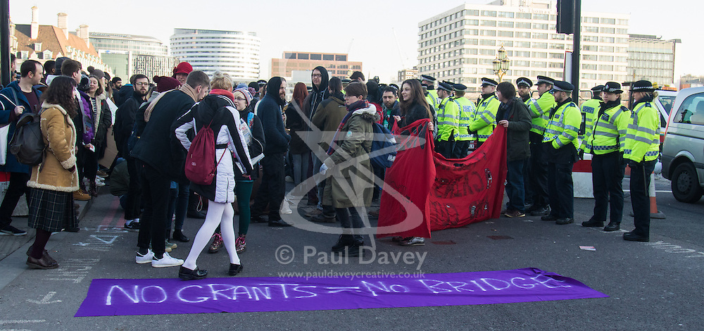 """Westminster, London, January 19th 2016. Students hold an """"emergency protest"""" in Parliament Square and later blocking Westminster Bridge, against the cutting of maintenance grants. """"It took just 18 MPs 90 minutes to scrap maintenance grants for the million poorest students, without a debate in Parliament in a backroom committee"""" PICTURED: Protesters block Westminster Bridge. ///FOR LICENCING CONTACT: paul@pauldaveycreative.co.uk TEL:+44 (0) 7966 016 296 or +44 (0) 20 8969 6875. ©2015 Paul R Davey. All rights reserved."""