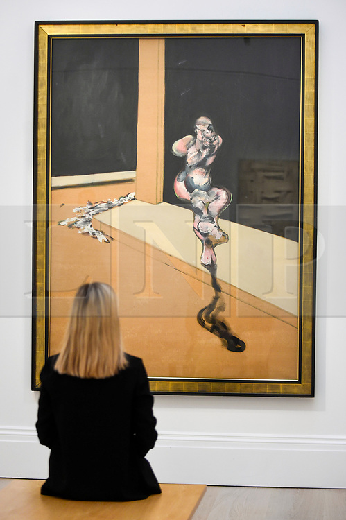© Licensed to London News Pictures. 07/02/2020. LONDON, UK. A staff member views ''Turning Figure'' by Francis Bacon, (Est. £6,000,000 - 8,000,000). Preview of Sotheby's Contemporary Art Sale in their New Bond Street galleries.  Works by artists including Francis Bacon, Yves Klein, Jean-Michel Basquiat and David Hockney will be offered for auction on 11 February 2020.  Photo credit: Stephen Chung/LNP