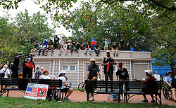 Counter-protesters sit atop a building in Lafayette Square Park to view the White Civil Rights demonstrators on the other side of the park in Washington, DC, USA on Sunday, August 12, 2018. The groups were kept separate by several fences and law enforcement. Photo by Darryl Smith/TNS/ABACAPRESS.COM