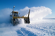 Alaska. Snow removal equipment quickly clears up after a storm.