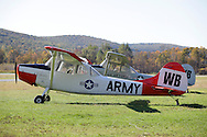 Wurtsboro, New York - Two 1964 Cessna 305 L-19 Bird Dog tow plansz are parked at Wurtsboro Airport on Oct. 9, 2010. The planes are used for towing gliders.