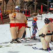 Kids and ski instructors dress up in costumes on their last day of winter sports school at Jackson Hole Mountain Resort.