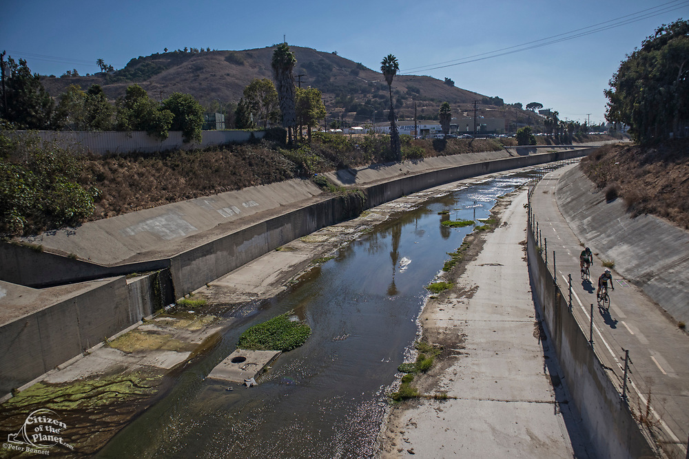 Ballona Creek bike path in Culver City. Once a meandering creek, Ballona Creek is now a concreted nine-mile flood channel that drains the Los Angeles Basin and watershed down into the Pacific Ocean, Culver City, California, USA