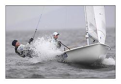 470 Class European Championships Largs - Day 2.Wet and Windy Racing in grey conditions on the Clyde...SLO64, Tina MRAK, Teja CERNE, Jk Pirat Portoroz ..