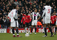 Photo: Lee Earle.<br /> West Bromwich Albion v Manchester United. The Barclays Premiership. 18/03/2006. United's Luis Saha (C) celebrates scoring their second as the Albion players look dejected.