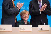 09 DEC 2014, KOELN/GERMANY:<br /> Peter Tauber (L), CDU Generalsekretaer, Angela Merkel (M), CDU, Bundeskanzlerin, und Volker Bouffier (R), CDU, Ministerpraesident Hessen, Merkel nimmt nach Ihrere Rede den Applaus der Delegierten entgegen, CDU Bundesparteitag, Messe Koeln<br /> IMAGE: 20141209-01-063<br /> KEYWORDS: Party Congress, applaudieren, klatschen