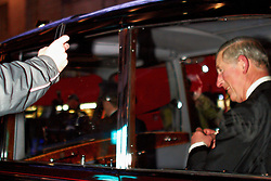 © under license to London News Pictures. 09/12/2010.  A protester films Prince Charles with a mobile phone as a mob surrounds the Royal Convoy in Regent Street after it is accidentally driven into the middle of a riot. A rioter physically attacks his wife Camilla, Duchess of Cornwall, through an open window. The Rolls Royce carrying the couple is splattered with paint and a window is smashed. Photo credit should read Cliff Hide/LNP.