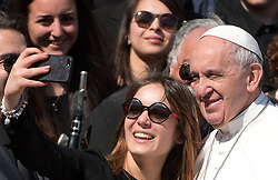 Pope Francis does a selfie with a young woman at the end of the weekly general audience in Saint Peter's square at the Vatican on March 15, 2017. Photo by Eric Vandeville/ABACAPRESS.COM  | 585874_018 Vatican Vatican Vatican (or Holy See)