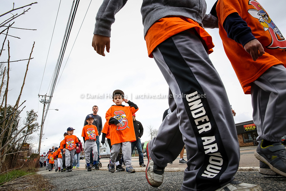 (4/27/14, MILFORD, MA) Little leaguers make their way down East Main Street during the Opening Day parade in Milford on Sunday. Daily News and Wicked Local Photo/Dan Holmes