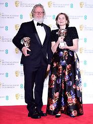 Tony McNamara and Deborah Davis with their Best Original Screenplay Bafta for The Favourite in the press room at the 72nd British Academy Film Awards held at the Royal Albert Hall, Kensington Gore, Kensington, London.