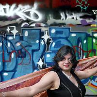 """Nederland, Amsterdam , 30 juni 2012..Usha Nalinie Marhé (Paramaribo, Suriname, 4 april 1964) is een Surinaams schrijfster..In oktober 1988 begint Marhé haar carrière als journalist in Paramaribo. In 1990 verhuist ze naar Nederland, waar ze als freelance journaliste blijft publiceren voor bladen als """"Opzij, De Groene Amsterdammer, Vrij Nederland en Onze Wereld"""". Voor het dagblad Trouw interviewt zij de Indiase superster Amitabh Bachchan, voor haar een persoonlijk hoogtepunt in haar carrière. Verder is zij in de jaren 90 enkele jaren lid geweest van de Werkgroep Migranten en Media van de Nederlandse Vereniging van Journalisten. In 2001 werkt ze als docent Journalistiek op de Academie voor Journalistiek in Tilburg..Foto:Jean-Pierre Jans"""