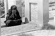 Woman weeps at the grave of her murdered child. Also known as Qadiani's The Ahmadiyyas are the followers of Hazrat Mirza Ghulam Ahmad Qadiani (1835-1908). According to his followers, he was the  founder of the Ahmadiyya Muslim Jama'at and The Promised Messiah and Imam Mahdi. The Ahmadiyya (Qadiani) movement in Islam is a religious organisation with more than 30 million members worldwide. Ahmadiyyas are now banned from calling themselves Muslim in Pakistan and suffer terrible discrimination under anti-blasphemy laws and are regularly murdered for their faith.