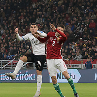 Luca Torreira (L) of Uruguay and Adam Nagy (R) of Hungary go for a header during the inauguration match of the newly reconstructed Ferenc Puskas Stadium between Hungary and Uruguay in Budapest, Hungary on Nov. 15, 2019. ATTILA VOLGYI